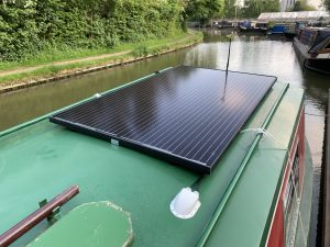 A 305W Jinko back contact solar panel fitted to a narrowboat.